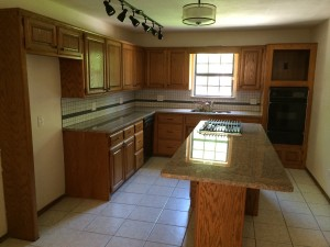 Big beautiful cooks kitchen with new appliances and granite island